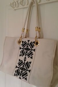 IMAN white leather tote with black & gold details